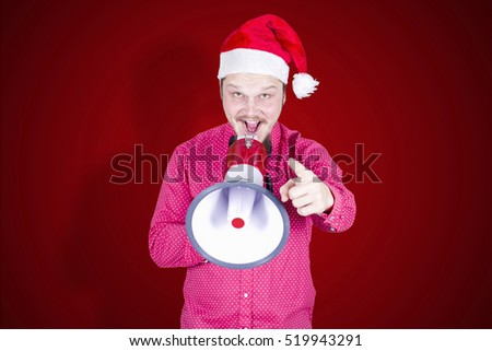 Businessman with Christmas hat and megaphone