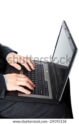 Businessman with laptop. Isolated on white.