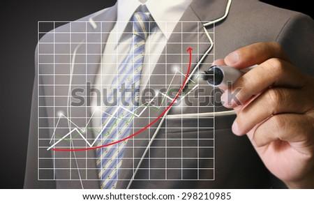 businessman write graph chart, financial - stock photo
