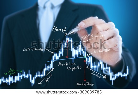 businessman writing head and shoulder pattern - stock photo