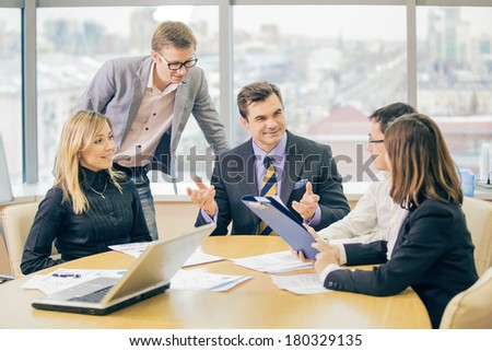 businesspeople interacting at meeting - stock photo