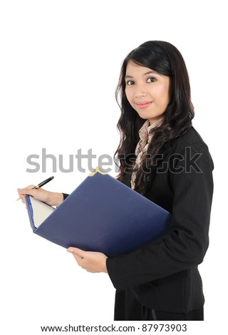 businesswoman holding a book and a pen isolated on white background - stock photo