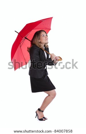 businesswoman holding a red umbrella - stock photo