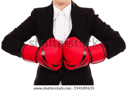 Businesswoman punching red boxing gloves together ready to fight  isolated on white background.