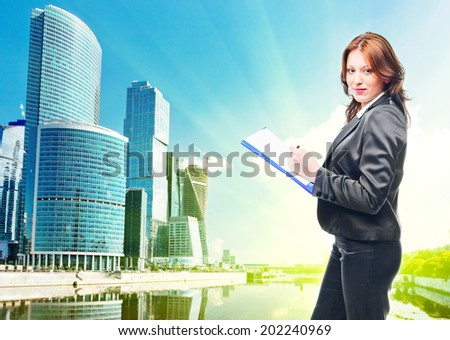 . Businesswoman standing in suit - stock photo