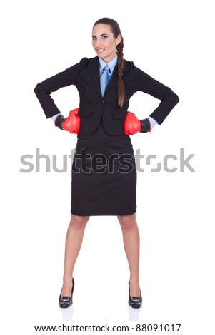 Businesswoman standing with boxing gloves ready for the competition, isolated on white background