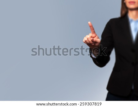 Businesswoman touch concept -  hand on focus, pointing - stock photo