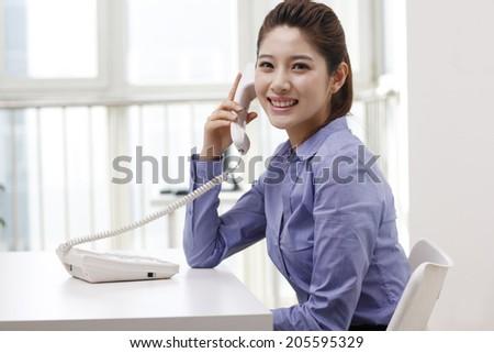 Businesswoman using a smart-phone - stock photo