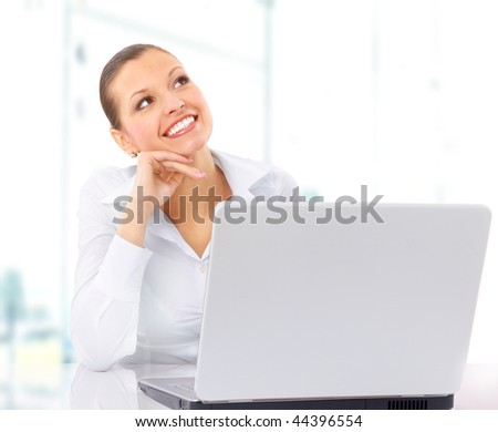 Businesswoman working at desk, isolated on white.