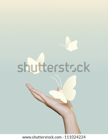 butterfly paper on hand.paper cut style