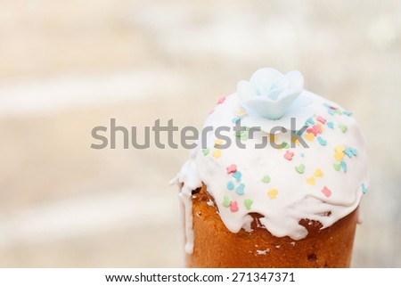 Cake glazed with colored figures of animals and flower on top - stock photo