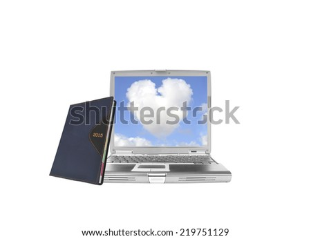 2015 Calendar Datebook leaning on laptop with heart shaped cloud blue sky isolated on white background - stock photo