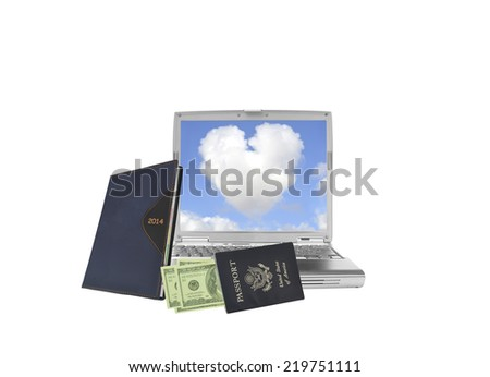 2014 Calendar Datebook with US passport and American currency leaning on laptop with heart shaped cloud blue sky isolated on white background - stock photo
