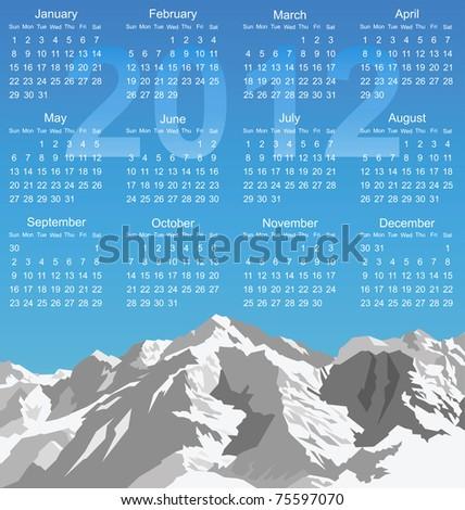 2012 calendar with snow capped mountain range - stock photo