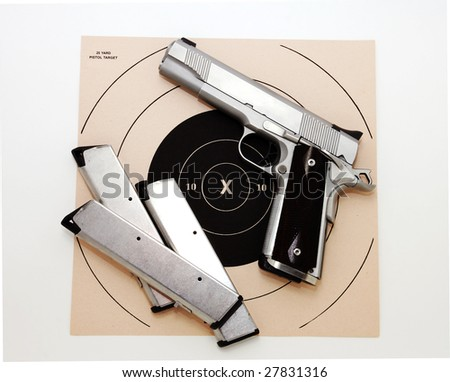 45 caliber pistol and target - stock photo