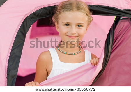 Camping in tent -  happy girl on camp tent - stock photo