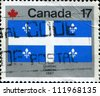"CANADA - CIRCA 1979: A stamp printed in Canada from the ""Canada Day. Flags"" issue shows Quebec flag, circa 1979. - stock photo"