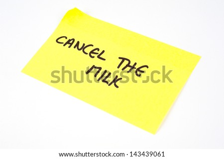 'Cancel The Milk' written on a yellow sticky note