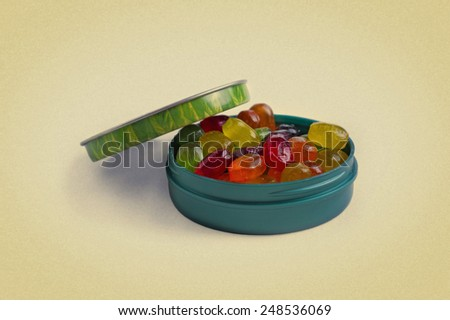 candies in a box on a white background. picture in retro style - stock photo