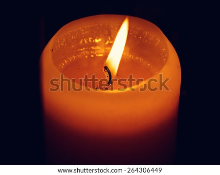 candle flame at night closeup - stock photo