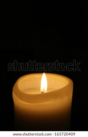 Candle light in the dark with copy space.