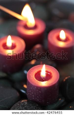 Candlelight and stones - spirituality - stock photo