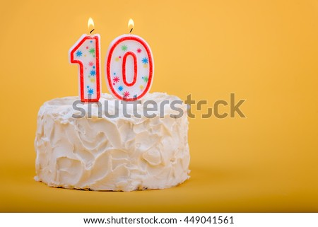 10 candles on a birthday cake for tenth birthday.  10th Birthday Cake - stock photo