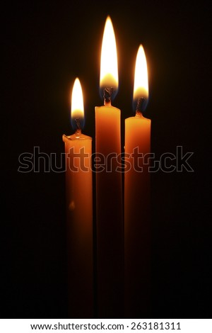 3 Candles on dark background