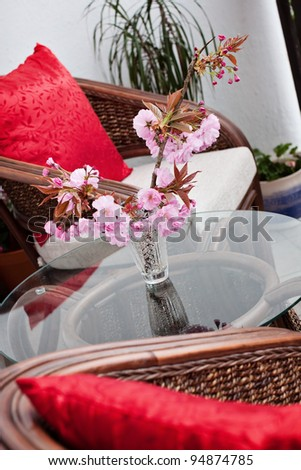 cane chairs and table on the balcony - stock photo