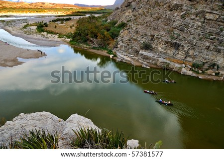 3 Canoe in River Rowing to Shore - Santa Elena Canyon, Big Bend National Park, USA - stock photo