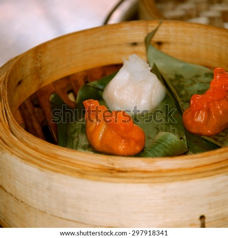Cantonese cuisine. Dim sum cooked in steamer baskets. - stock photo