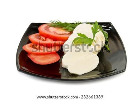 """Caprese"" salad with mozzarella cheese - stock photo"