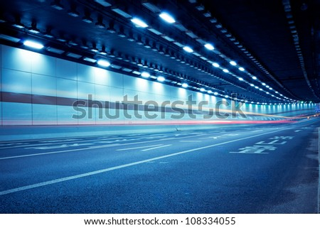 car in the tunnel trajectory - stock photo