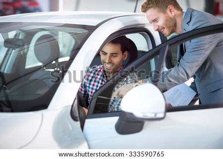 car manager kindly show car customer  - stock photo