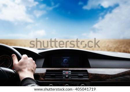 car window view on wheat field - stock photo