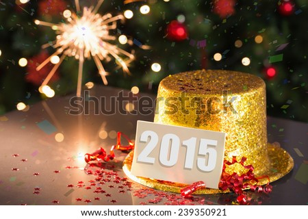 2015 card on table set for party with gold hat and champagne - stock photo
