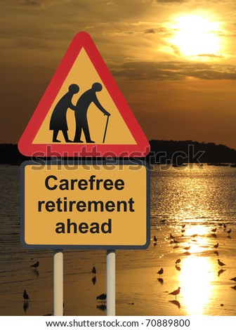 Carefree retirement roadsign for elderly seniors with a sunset - stock photo