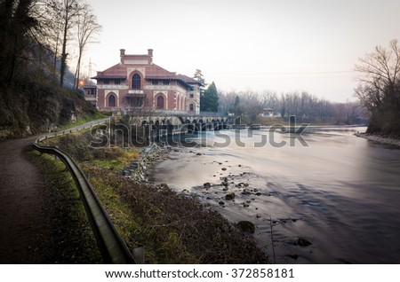 """Carlo Esterle"" hydroelectric power plant is one of  the hydro electric plants placed along the Adda river in Italy, perhaps the most beautiful for its architectonics beauty - stock photo"