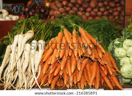 Carrot. Fresh raw taste new vegetables on farmers market - stock photo