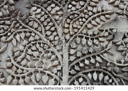 carve stone wall of Angkor wat - stock photo