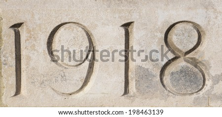 """""""1918"""" carved in stone at Tyne Cot War Cemetery, Flanders, Belgium.  Commemorating World War One  - stock photo"""
