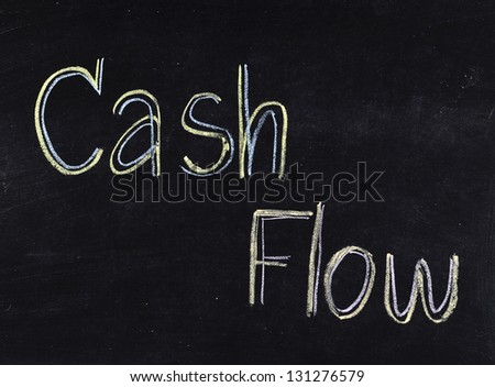 """Cash flow"" handwritten on blackboard"