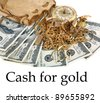 """Cash for gold"" or ""Cash 4 Gold"" a leather pouch filled with gold jewelry lays upon a pile of cash isolated on white with room for your text. represents CASH FOR GOLD business concepts - stock photo"