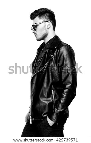 Casual handsome attractive man hipster guy wearing leather jacket  on white background black and white photo - stock photo