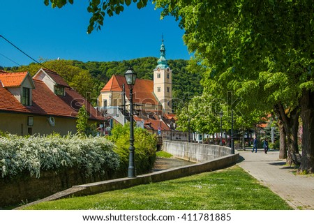 Catholic church and river in the center of Samobor, town in northern Croatia  - stock photo