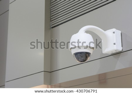 CCTV Camera Operating inside a airport and train station or department store,Security surveillance camera hanging from drop ceiling,selective focus  - stock photo