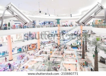 cctv security camera system at department store - stock photo