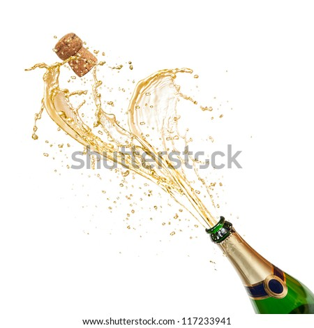 Celebration theme with splashing champagne - stock photo
