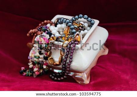 Ceramic casket with jewelry - stock photo
