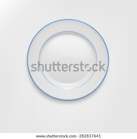 ceramic plate with a blue border - stock photo